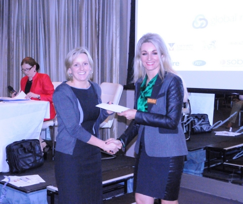 Ms. Siobhan McCoy receives her prize from Marie Friel, Leo Pharma representative