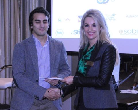 Dr Vinesh Ramiah (SpR in EM, Mater Misericordiae University Hospital) receives his prize from Leo Pharma representative Marie Friel