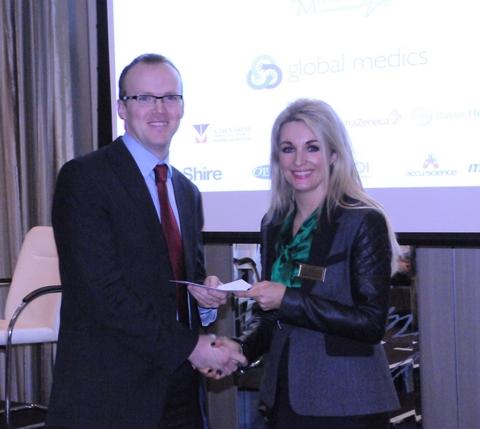 Dr John Cronin (SpR in EM) receives his prize from Leo Pharma representative Marie Friel