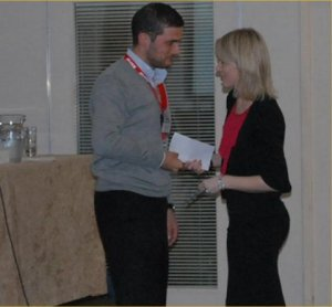 Dr Michael Quirke (SpR in EM) receiving his prize from Orla O'Donnell, Critical Care Representative, Leo Pharma