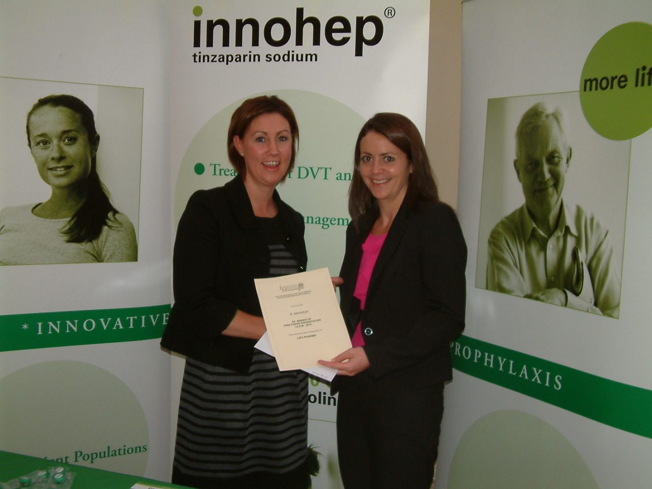 Dr. Karen McHugh (SpR in EM), on the right, receiving her award from Judy Fleming of Leo Pharma